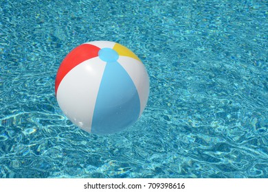 beach ball floating in swimming pool