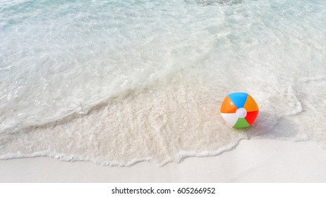 Beach ball on the sea water background