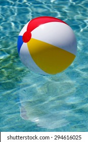 Beach Ball In Swimming Pool Vertical Shot/ Time To Play In Swimming Pool