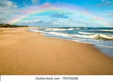 beach of Baltic Sea, Poland with rainbow