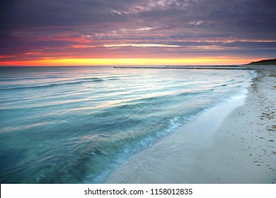 beach at baltic sea with sand dunes and beautiful sunrise