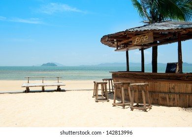 Beach bar locate on the sand ready to service chill liquor alcohol drink party or best view in villa resort using relax for leisure travel summer background vacation seaside blue skyline copy space