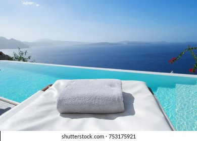 beach bed chair with towel looking out over the caldera by the swimming pool , Santorini Oia