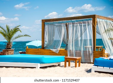 Beach bed and sunloungers in a beach