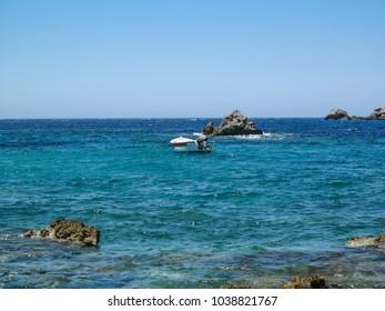 beach in Benitses village, Greece, Corfu