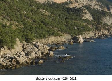 Beach between rocks and sea. Near Balaklava/Sevastopol, Crimea peninsula, Black Sea, Ukraine.