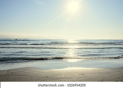 Beach of Black Sea from Mamaia, Romania with blue clear water and golden sand.