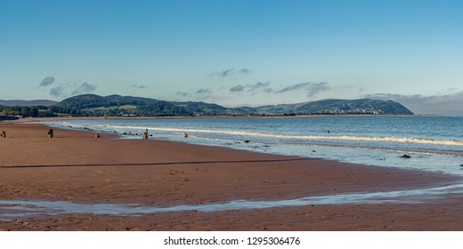 The beach in Blue Anchor, Somerset, England, UK - looking at the Bristol channel and Minehead in the background