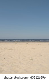 beach, blue sky, white sand and a strip of the sea, background