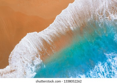 Beach and blue water with waves