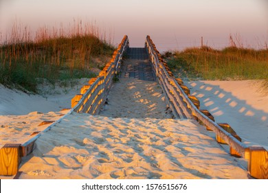 Beach boardwalk covered with sand on the Cape Hatteras National Seashore in Salvo, North Carolina on the Outer Banks.