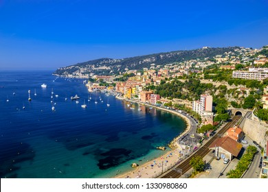 Beach with boats in Beausoleil, Nice, Nizza, Alpes-Maritimes, Provence-Alpes-Cote d'Azur, Cote d'Azur, French Riviera, France