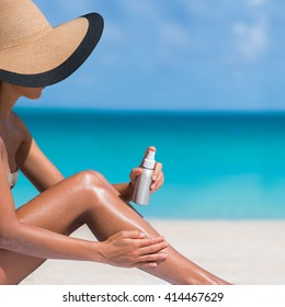 7ff99e99e13d0 Beach body suntan skin care travel vacation. Bikini hat woman applying  sunscreen lotion putting cream