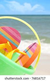 beach bucket and flip flops