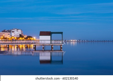 Beach cabin on San Pedro del Pinatar coast, Spain at sunset