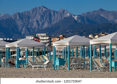 Beach Cabins on the Sand, With Mountains in the Background, in the Resort Town of Viareggio, Italy