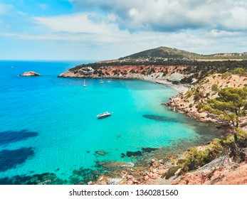 Beach of cala d'hort and cliff in Ibiza, Spain at summer