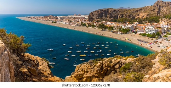The beach at Calahonda, Spain projects into the Mediterranean Sea in summertime