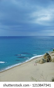 Beach of Calella on a cloudy day