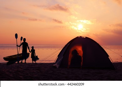 Beach Camping,The image of family camping and activity on the beach in the morning with blue sky and sunrise.