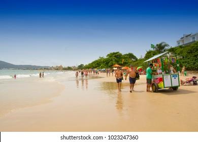 The beach Canasvieiras, Florianopolis, Santa Catarina, Brazil, January 2018 - people on the beach are spending time