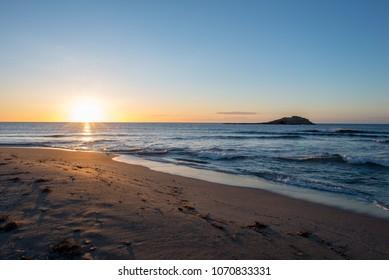 The beach of Carboneras in almeria at sunrise, Spain