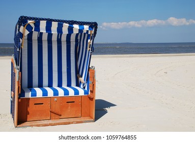 Beach chair at the beach of Amrum - North Sea - Germany. Amrum is one of the North Frisian Islands on the German North Sea coast, south of Sylt and west of Foehr