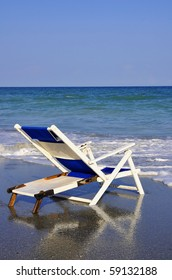 Beach Chair by the sea shore, perfect for cover art