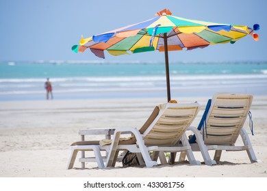 beach chair with colorful umbrella on the beach