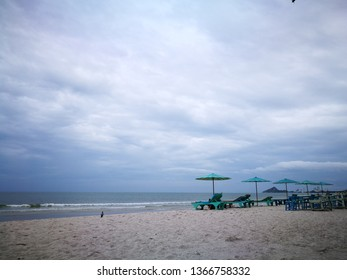 beach chair and green umbrella on the beach. minimal lifestyle people walk on beautiful white sand at beach, Summer vacation.