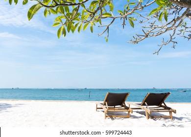 Beach chair, leaf and tropical beach at Pattaya in Thailand