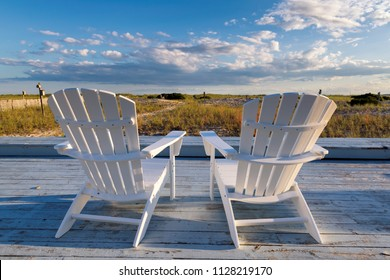 Beach chair on Cape Cod beach at sunset, Cape Cod, Massachusetts, USA.