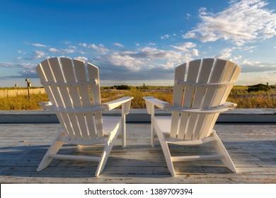 Beach chair on Cape Cod beach at sunset, Cape Cod, Massachusetts, USA.