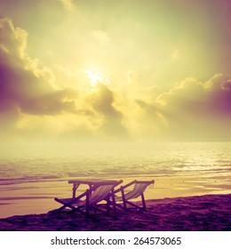 beach chair on the beach with sunset