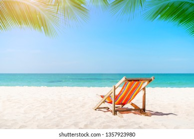 Beach chair on the tropical beach in Thailand with blue sky in sunny day. Summer vacation and holiday.