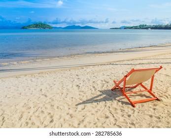 beach chair on whit sand beach