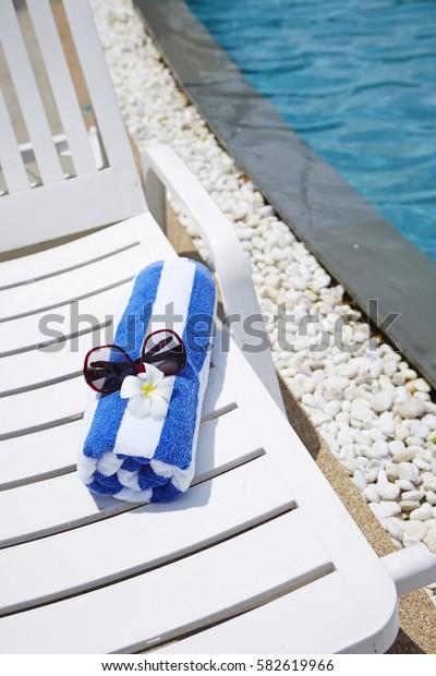 Beach chair at poolside