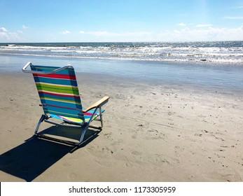 Beach chair at the seashore.