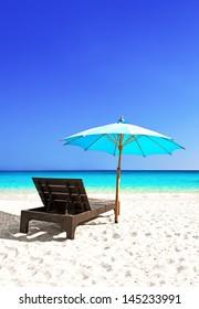 Beach chair with umbrella and beautiful sand beach