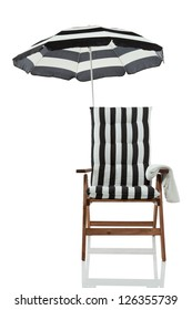 Beach chair with umbrella isolated on white