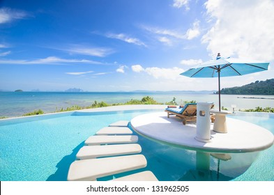 beach chair with umbrella on private pool, ocean view