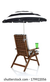 Beach chair with umbrella, towel and drink behind angle view