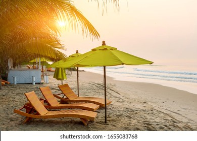 Beach chair under the big umbrella and was on the beach. Beautiful beach. Chairs on the sandy beach near the sea. Summer holiday and vacation concept for tourism. Inspirational tropical landscape.