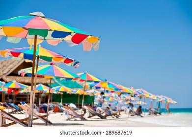 Beach chair under the umbrella of colorful on the beach Phuket, Thailand