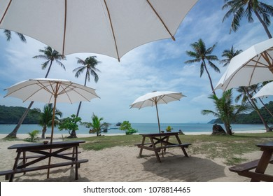 Beach chairs with beautiful beach and cloudy sky. Summer holiday and Vacation concept background. Mu Koh Angthong Nationnal Park, Koh Samui Thailand