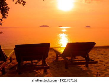 Beach chairs and beautiful sunset on Tropical beach background as summer