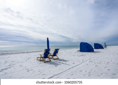 beach chairs and cabanas on navarre beach florida by ocean