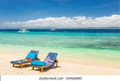 Beach chairs, clear water and beautiful view