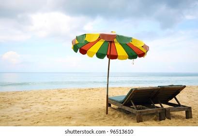 beach chairs and colorful umbrella on the beach, Phuket Thailand