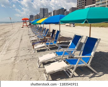 Beach chairs lined up in Myrtle Beach South Carolina.